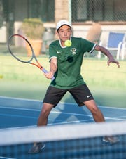 The Pensacola Catholic High School tennis team practices at the Roger Scott Tennis Center in Pensacola on Thursday, Feb. 27, 2020.