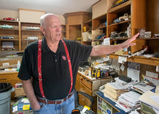 Owner Ken Dowell talks about the potential impact of the future Santa Rosa County Courthouse being built across the street from his Ken's Paint & Body business on Avalon Boulevard in Milton.