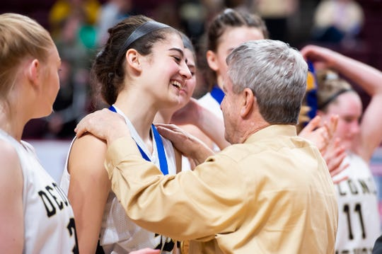 Delone Catholic's Maddie Sieg smiles as head coach Gerry Eckenrode gives her a championship medal following the District 3 Class 3A championship game at the Giant Center in Hershey on Thursday, Feb. 27, 2020. The Squirettes won, 44-22.