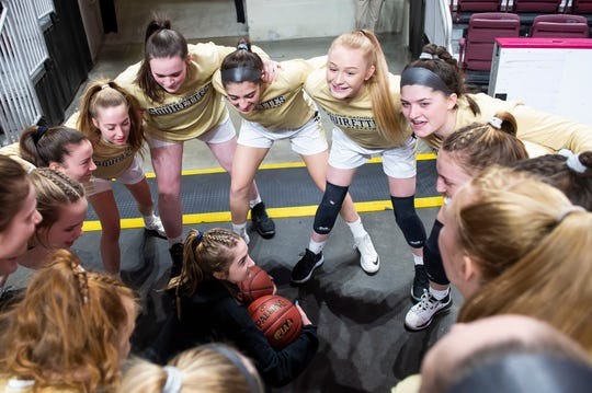 The Delone Catholic Squirettes huddle up prior to the District 3 Class 3A championship game against Trinity at the Giant Center in Hershey on Thursday, Feb. 27, 2020. The Squirettes won, 44-22.
