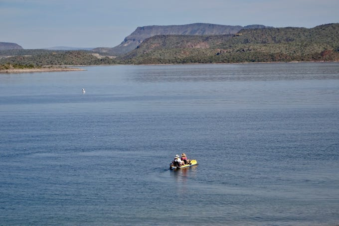Kayaker and rafters at Lake Pleasant have miles of shoreline and sheltered coves to explore.