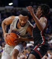 GCU's Isiah Brown drives against New Mexico State's Terrell Brown (3) during the first half at Grand Canyon University in Phoenix, Ariz. on Feb. 27, 2020.