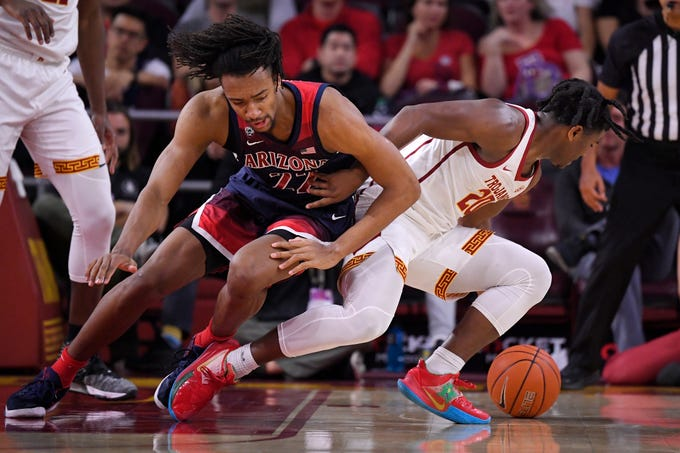 Arizona forward Zeke Nnaji, left, and Southern California guard Ethan Anderson go after a loose ball during the first half of an NCAA college basketball game Thursday, Feb. 27, 2020, in Los Angeles. (AP Photo/Mark J. Terrill)