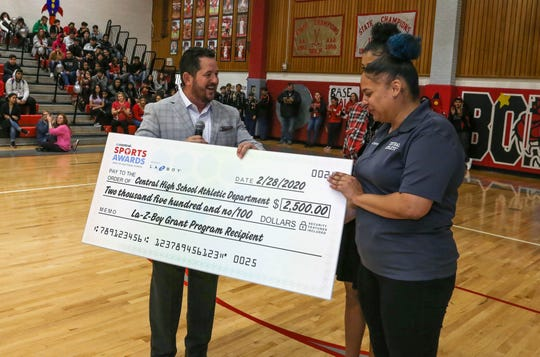 Frank Neal. President of La-Z-Boy Arizona, prsents a check to representatives of the Central High School athletic department Friday, Feb. 28, 2020.