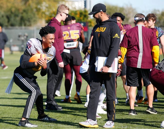 ASU quarterback Jayden Daniels (left) has a laugh during spring football practice at Kajikawa Practice Facility in Tempe on Feb. 27, 2020.