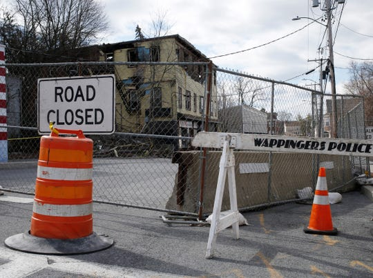 Barricades block access to Market Street in the Village of Wappingers Falls which is closed due to the severity of the damage to a building following Tuesday's fire.
