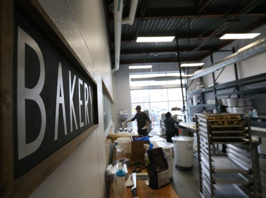 Bakers prepare cookie dough at Jane Bakes' new location in Fishkill on February 27, 2020. The location will offer a cafe that looks in on their production line.