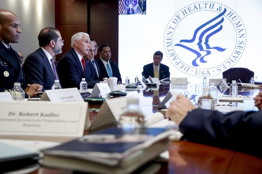 Vice President Mike Pence, third from left, accompanied by Surgeon General Jerome Adams, left, Health and Human Services Secretary Alex Azar, and others, speaks during a coronavirus task force meeting at the Department of Health and Human Services, Thursday, Feb. 27, 2020, in Washington. (AP Photo/Andrew Harnik)