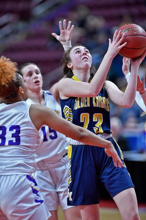 Eastern York's Mara Weaver, right, seen here in a file photo, scored 19 points for the Golden Knights on Saturday in a win over Columbia.