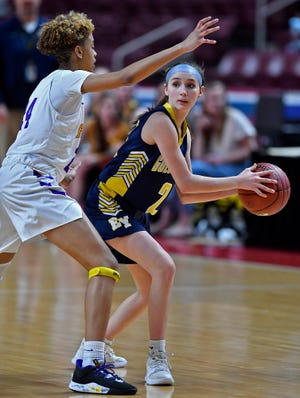 Eastern York's Breana Grim looks to pass while covered by Bryanna Hicks of Lancaster Catholic during the District 3 Class 4-A girls's basketball final, Thursday, February 27, 2020.John A. Pavoncello photo