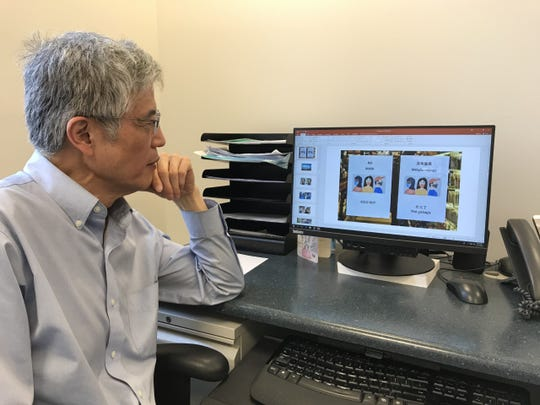 Zehao Zhou follows developments about the coronavirus in his native China in his office at York College.