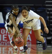 Spanish Springs' Autumn Wadsworth and Desert Oasis' Sesi-rae Young chase a loose ball during the State playoff game at Lawlor Events Center on Thursday.