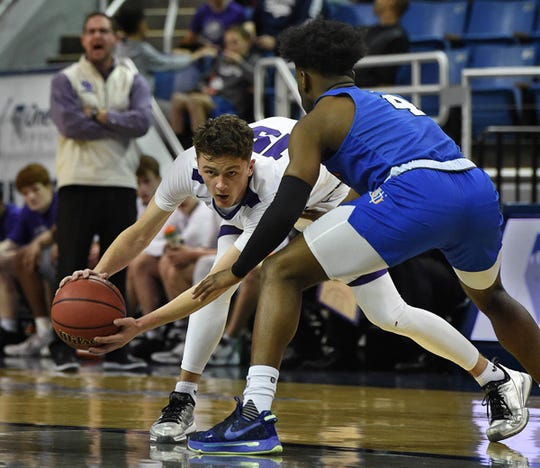 Spanish Springs' Mason Whittaker looks to pass the ball with Gorman's Jonathan Braggs covering him during Thursday's State playoff game at Lawlor Events Center.