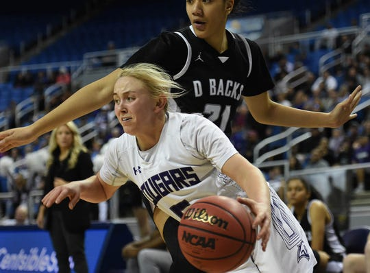 Spanish Springs' Megan Gower drives past Desert Oasis' Latahemo Fakahafua during the State playoff game at Lawlor Events Center on Thursday.