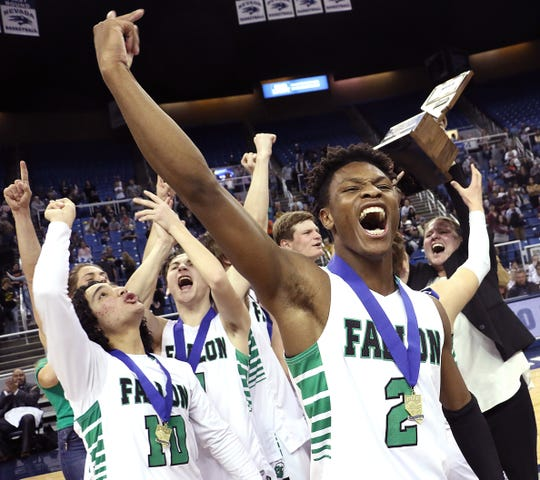 Fallon's Elijah Jackson (2) celebrates with his team after hitting the game winning shot in overtime to defeat Elko for the NIAA 3A Boys Basketball championship at Lawlor Events Center in Reno on Feb. 28, 2020.