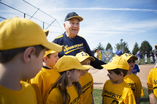 Baseball legend Johnny Antonelli gets a Little League team together for a photo during the Spencerport junior baseball and softball opening day in 2015.