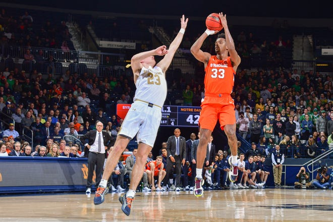 Syracuseforward Elijah Hughes (33) shoots a three-point basket over Notre Dame guard Dane Goodwin (23) in the first half of a game earlier this season.