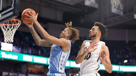 North Carolina forward Armando Bacot (5) reaches for a rebound with Wake Forest's center Olivier Sarr (30) in the first half of an NCAA college basketball game Tuesday, Feb. 11, 2020 in Winston-Salem, N.C.