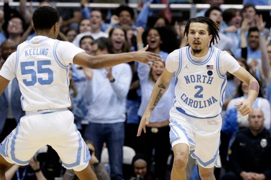 North Carolina guard Christian Keeling (55) and guard Cole Anthony (2) react following a play against North Carolina State during the second half of an NCAA college basketball game in Chapel Hill, N.C., Tuesday, Feb. 25, 2020. North Carolina plays at Syracuse on Saturday afternoon.