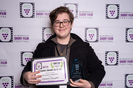 """Braeden Olheiser, a junior at McNary High School, pictured at the McMinnville Short Film Festival on Feb. 22, 2020. He won the Grade 6-12 Student Award for his short film, """"Tandem Thoughts."""""""
