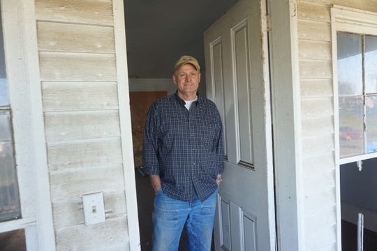 Jeff Nielsen, standing inside the front door of the historic Sam Brown House on Thursday, Feb. 27, 2020, plans to restore the 1857 house.