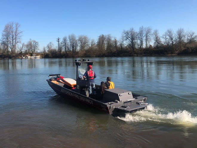 Officials are investigating after a partially decomposed male body was discovered in the Willamette River near Buena Vista Ferry Thursday.