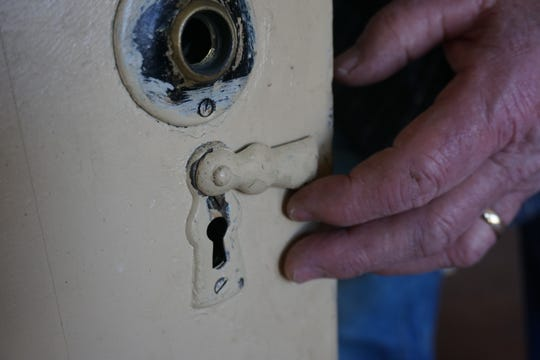 Some of the doorknobs and hardware has been stolen from historic Sam Brown House, but not this keyhole with sliding cover.