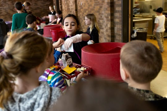 Students are given responsibilities throughout the school day, including helping to clear lunch trays at the EAGLE Charter School in Salem on Feb. 27, 2020.