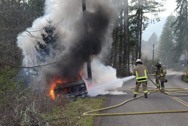 Crews extinguished flames coming from a pick-up truck that rolled off the road near Sheridan Wednesday.