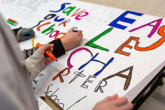 "Students fill-in the characters of ""SAVE OUR SCHOOL"", ""EAGLE CHARTER"" in Salem on Feb. 27, 2020."