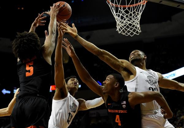 EUGENE, OREGON - FEBRUARY 27: Chandler Lawson #13 of the Oregon Ducks and Francis Okoro #33 battle for a rebound with Ethan Thompson #5 of the Oregon State Beavers and Alfred Hollins #4  during the first half at Matthew Knight Arena on February 27, 2020 in Eugene, Oregon. (Photo by Steve Dykes/Getty Images)