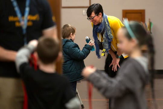 Principal Dr. Marie C. Ballance speaks with a student in the hall before MicroSociety period at the EAGLE Charter School in Salem on Feb. 27, 2020.