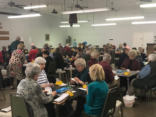 The Suez Temple in San Angelo buzzes with activity during the Saturday afternoon game of the Fort Concho Sectional Tournament of the American Contract Bridge League.