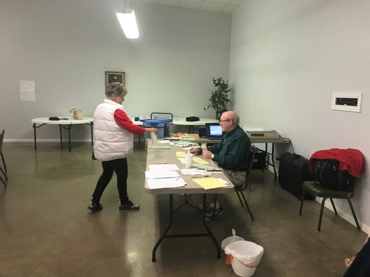 Marifrances Watson checks in for the 1:30 p.m. game with Director Tom Marsh during the San Angelo Sectional Tournament held Feb.  22, 2020.