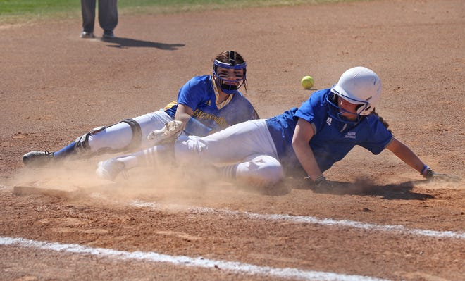 Mikaila Wagner, right, slides into third base for Lake View during a game against Reagan County at the Concho Classic Softball Tournament on Friday, Feb. 28, 2020.