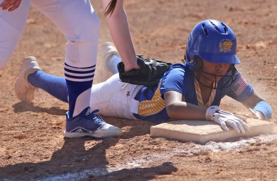 Andrea Cervantes, right, makes it back safely to first base for Reagan County after a pick-off attempt during a game against Lake View at the Concho Classic Softball Tournament on Friday, Feb. 28, 2020.