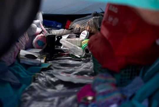 """A bottle of medicine and other personal items inside Peake's tent. Often, while camping, """"I didn't take as much medicine to try to make it last longer,"""" says Susan Peake, who lives at the state-run homeless encampment."""