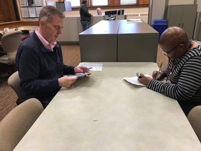 Assistant City Clerk Denise Tucker goes through nominating petitions submitted Friday afternoon by Councilor Pat Starr. Though the 74 signatures he submitted is enough to secure a place on the ballot, his name won't appear on it during the April 14 election because he is running unopposed.