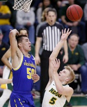 SDSU's David Wingett attempts to block a shot by NDSU's Sam Griesel.
