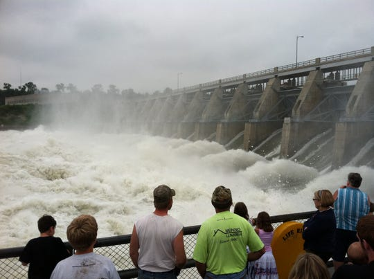 People watch water flowing through Gavins Point Dam at 150,000 cubic feet per second during record flooding in 2011. (Jay Pickthorn/Argus Leader)