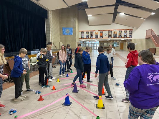Dell Rapids students work with robots in the STEM research area.