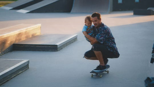 """Zack Mulligan and his infant son, Elliot, are shown in a still from """"Minding the Gap,"""" a 2018 documentary nominated for an Oscar last year that will be screened at the upcoming Rated SGF film festival. The documentary chronicles the lives and friendships of three young men growing up in Rockford, Illinois, united by their love of skateboarding."""
