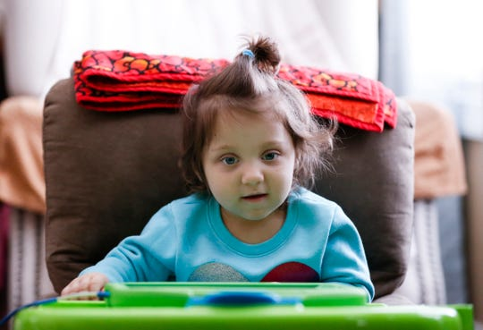 Two-year-old Regann Moore watches videos on her iPad at home on Thursday, Feb. 20, 2020. Moore has a rare disease know as, Krabbe Disease, and received a life-saving stem cell donation less than a month after being born.