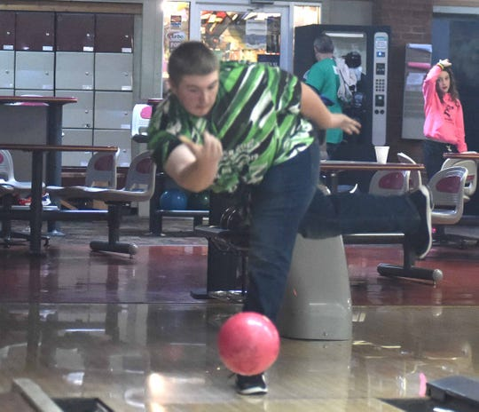 D.J. DePriest throws a practice ball following a Saturday morning bowling league at Staunton Lanes.