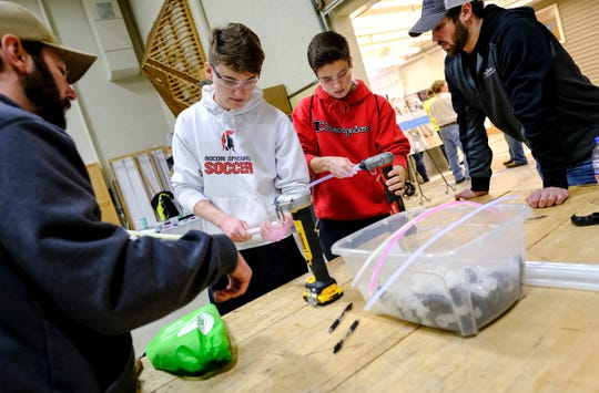 ROCORI students Joshua Johnston and Shane Holthaus work with PEX tubing and parts during the EPIC 2020 event Friday, Feb. 28, 2020, at St. Cloud Technical and Community College in St. Cloud.
