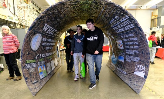 Students walk through a display in the Agriculture, food and Natural Resources area during the EPIC 2020 event Friday, Feb. 28, 2020, at St. Cloud Technical and Community College in St. Cloud.