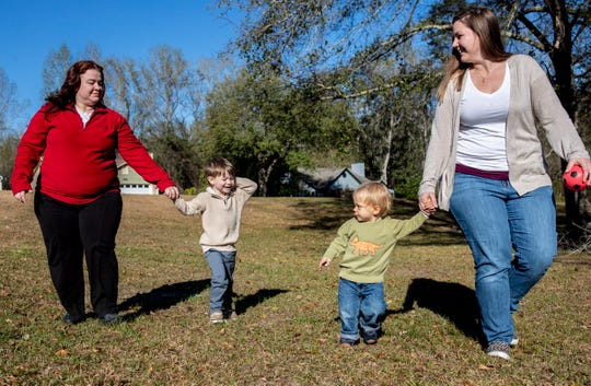Kelly Ashling, left, walks with her son Korbin, 4, and their friends, Everett, 1, and his mom Jessica Sewell, Friday, Feb. 28, 2020. The two families became friends while their boys were in the hospital for open-heart surgeries in Jan. 2020.
