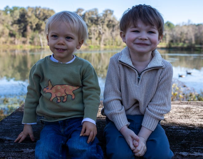 Everett, 1, left, sits with his friend Korbin, 4, Friday, Feb. 28, 2020. The two boys became friends when they both received open-heart surgery in Jan. 2020.