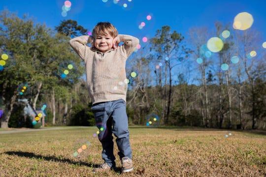 Korbin, 4, smiles as he plays with bubbles, Friday, Feb. 28, 2020. Korbin had open-heart surgery in Jan. 2020.