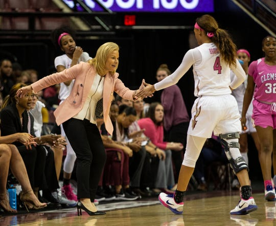 Florida State Seminoles head coach Sue Semrau high fives Florida State Seminoles guard Amaya Brown (4) as she comes off the court. The Florida State Seminoles lead the Clemson Tigers 42-23 at the half, Thursday, Feb. 28, 2020.
